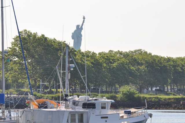 "The Statue of Liberty from our anchorage.  Note the anchored trawler, ""Emily Grace"" in the foreground."
