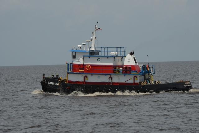 Workboats also travel across the big lake.