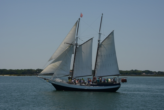 A schooner whispers across the sound at St. Augustine.