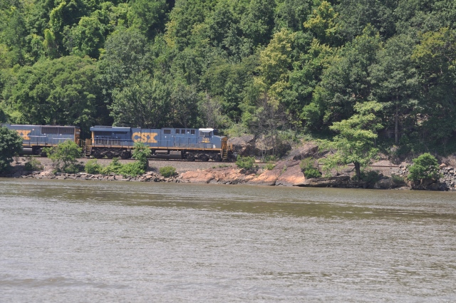 Trains run along the river's edge day and night.