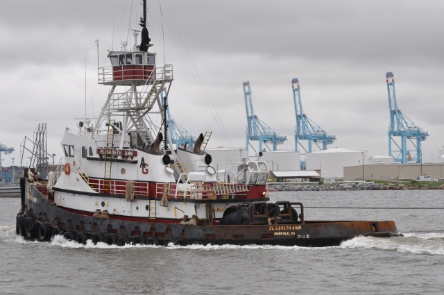 Workboats ply the harbor.