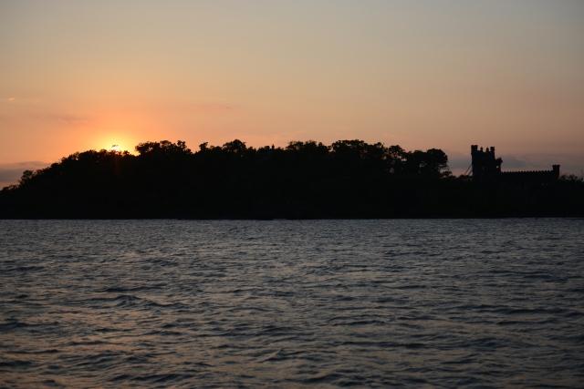 The setting sun silhouettes Bannerman's Castle.