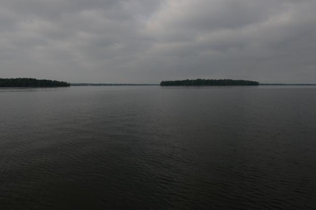 Frenchman and Dunham Islands on a calm Lake Oneida.