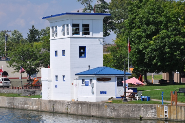 An old lock house at  adorns the shore.