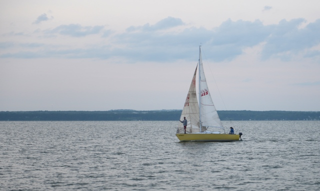 Sailboats cruising by are an added attraction on the lake.