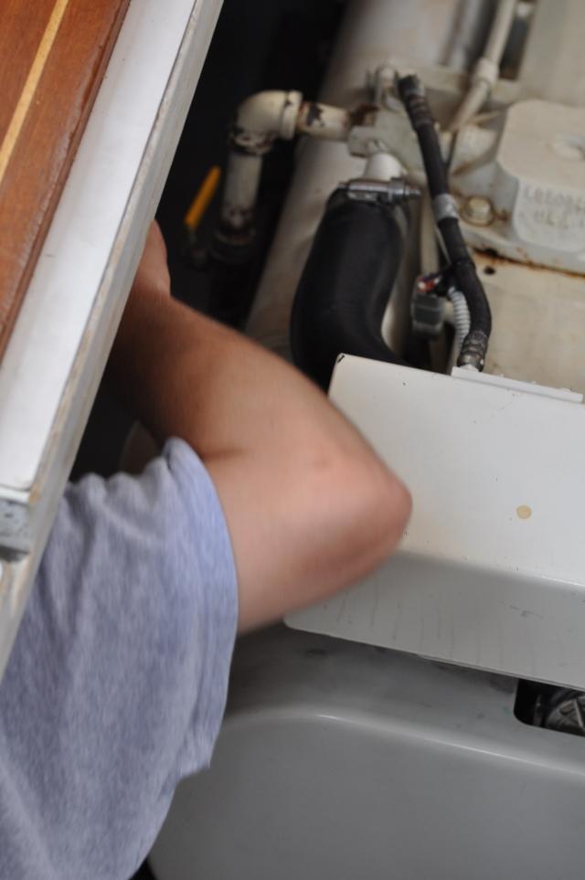 The Winter Harbor Marina mechanic helping the engine through its discomfort.
