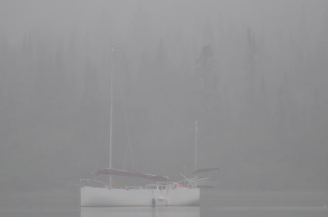 Sailboat anchored in the fog at Michipicoten Island, Lake Superior