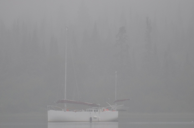 Sailboat anchored in the fog at Michipicoten Island, Lake Superior