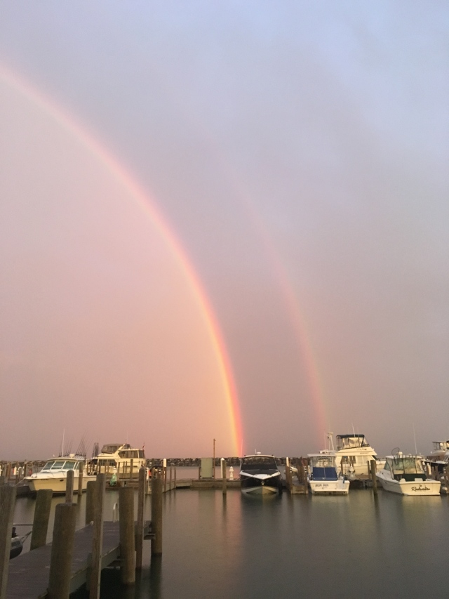 A rainbow between two storms at daybreak; Fishtown, Michigan